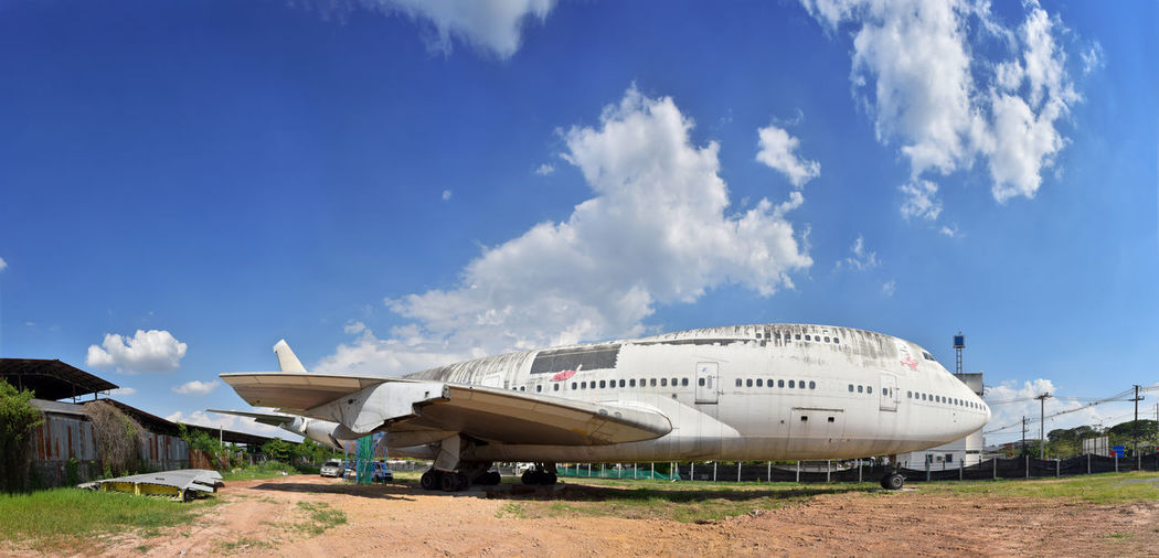 Panoramic view of airport and building against sky