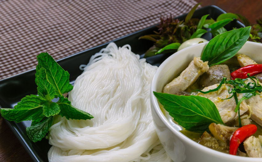 High angle view of rice vermicelli with meat in bowl