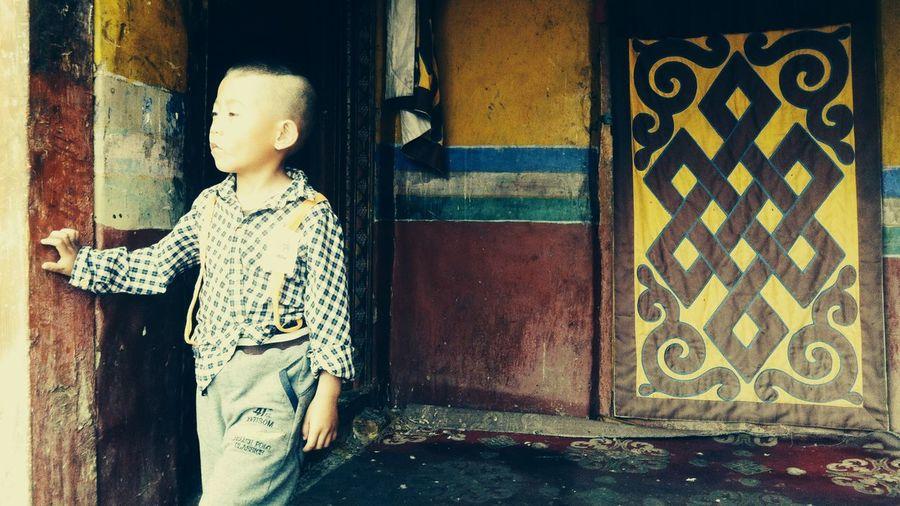 Full length of boy standing on floor
