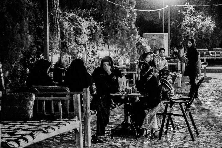 iranian ladies enjoyed dinner at the beautiful garden :) they were laughing and relaxed ;IranaTravelingnTraveling In IranaBlackandwhitetTravel PhotographyhEnjoying LifefShades Of GreyePersianaDinner Timeme