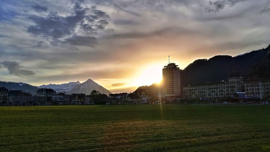 Sunlight Sunset Interlaken Berner Oberland Bernese Oberland Switzerland City Sky Grass Architecture Tower