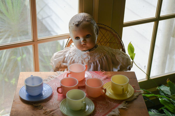 Tea party 1349 Antique Casual Clothing Childhood Cups Cups And Saucers Cute Dog Doll Eating Indulgence Leisure Activity Lifestyles Old Play Portrait Pretend Ready-to-eat Refreshment Table Vintage Vintage Toys