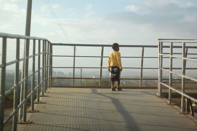 Boy Bridge - Man Made Structure Day Full Length One Person Only Men Outdoors People Railing Real People Rear View Sky
