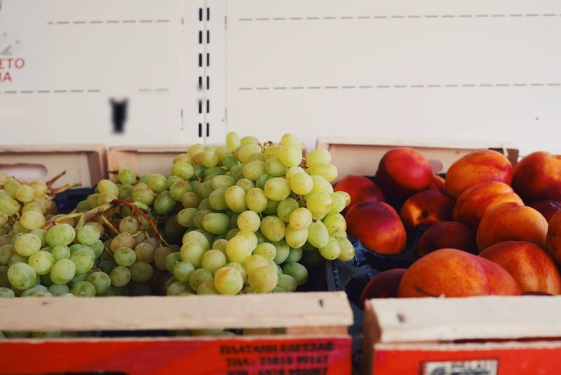 Fruit Food And Drink Food Healthy Eating Freshness Indoors  Grape No People Day Price Tag Close-up Marketplace Grapes Nectarines Nectarine Sweet Food Sweet Fruits Green Grapes Market Stall Fruit Market Fruitmarket Large Group Of Objects Indoors  Abundance Sweet Fruit