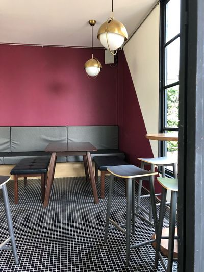 Empty seat corner Interior Decorating Seat Indoors  Lighting Equipment Chair No People Pendant Light Table Ceiling Restaurant Home Interior Absence Building Wall - Building Feature Architecture Hanging Built Structure Day Window Furniture Illuminated