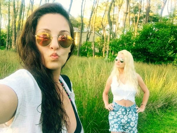 Hello World Selfie ✌ Nature Naturelovers Lifeisbeautiful Long Trees Holidays Green Green Green!  Sunglasses Summertime Life Is Beautiful Hot Day Friends Girls Blonde And Brunette Trees Relax Walking In Nature  Sunshine ☀ Women Color Of Life Color Of Nature Us