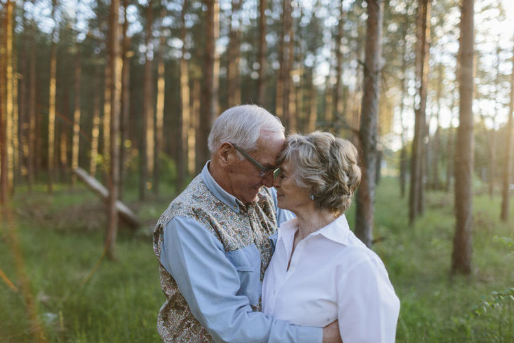 Rear view of couple kissing in forest