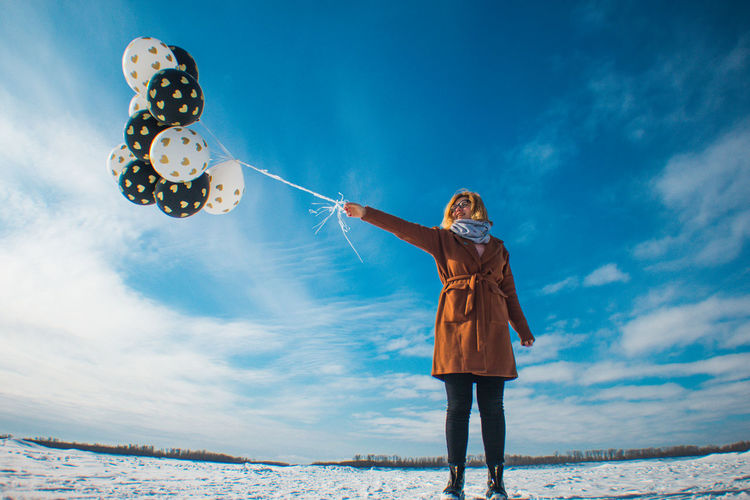 Sky One Person Standing Winter Nature Blue Cloud - Sky Holding Leisure Activity Child Three Quarter Length Day Casual Clothing Front View Looking Up Women Young Adult Warm Clothing Outdoors Digital Composite The Great Outdoors - 2019 EyeEm Awards