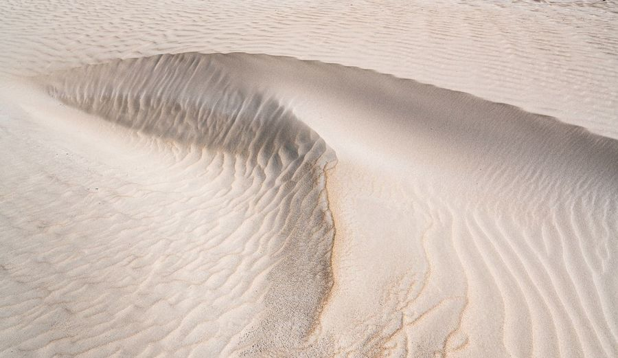 High angle view of sand dunes at beach