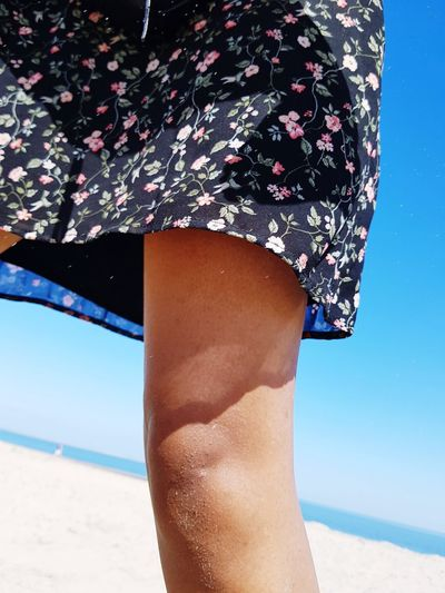 Beach Sand Human Leg One Person Vacations One Woman Only Only Women Adult People Summer Adults Only Leg Sea Human Body Part Day Outdoors Nature Young Women Sky Bodypartphotography EyeEm Body & Fitness Flowersdress Fashion Knee EyeEmNewHere