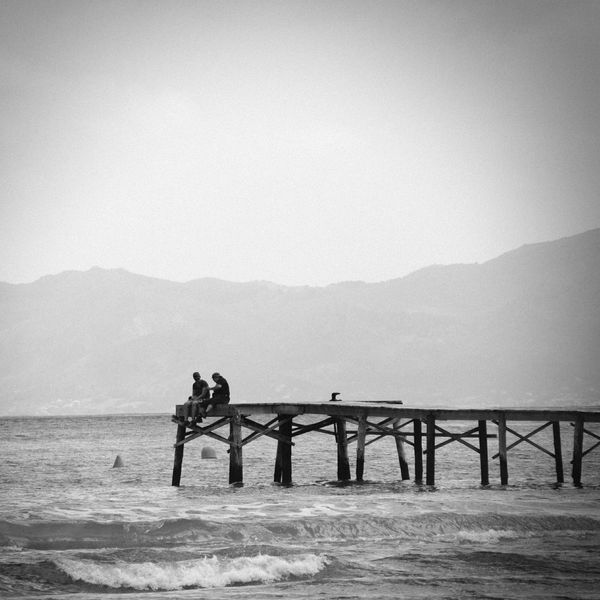 Holiday Travel Port D'Alcúdia Black And White Jetty People Watching Beach Sea Waves Mountains View Clouds Sky Nikon D7000 EyeEmBestPics