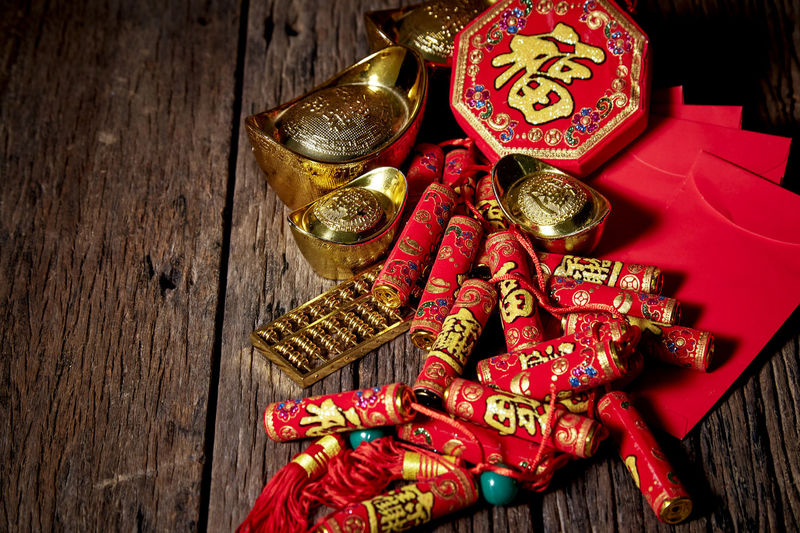 Chinese New Year Lunar New Year Good Luck Decoration Festive Wooden Table Luck Mascot Flat Lay Celebration Craft Firecrackers Ornament Gold China 2020 2019 Pig Minimal Sales Envelope Celebrations Flowers Lucky Tradition Symbol Red Fu Background Festival Spring Holiday Traditional Gold Culture Oriental Fortune Asian  ASIA Packet Plum Blossom Design Celebrate Greeting Prosperity Auspicious Money Happiness Firecracker Ingot Wood - Material Still Life Indoors  No People Text High Angle View Large Group Of Objects Close-up Gold Colored Communication Non-western Script Script Art And Craft