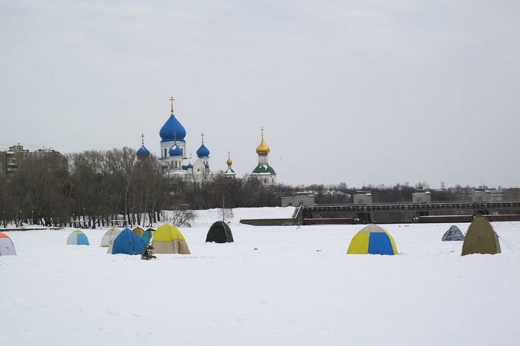 Winter fishing on Moscow River Ice Ice Fishing Moscow River Architecture Building Exterior Built Structure Canvas Tent Church Architecture Cold Temperature Dam Day Dome Embankment Ice Field Ice Fishing Huts Nature No People Outdoors Place Of Worship Religion Sky Snow Spirituality Tents Winter