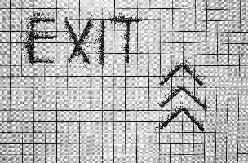 Dark Text Textured  Abstract Arrow Symbol Art Backgrounds Close-up Day Exit Exit Sign Full Frame No People Outdoors Pattern Structure The Way Forward Tile Streetwise Photography The Architect - 2019 EyeEm Awards The Creative - 2019 EyeEm Awards
