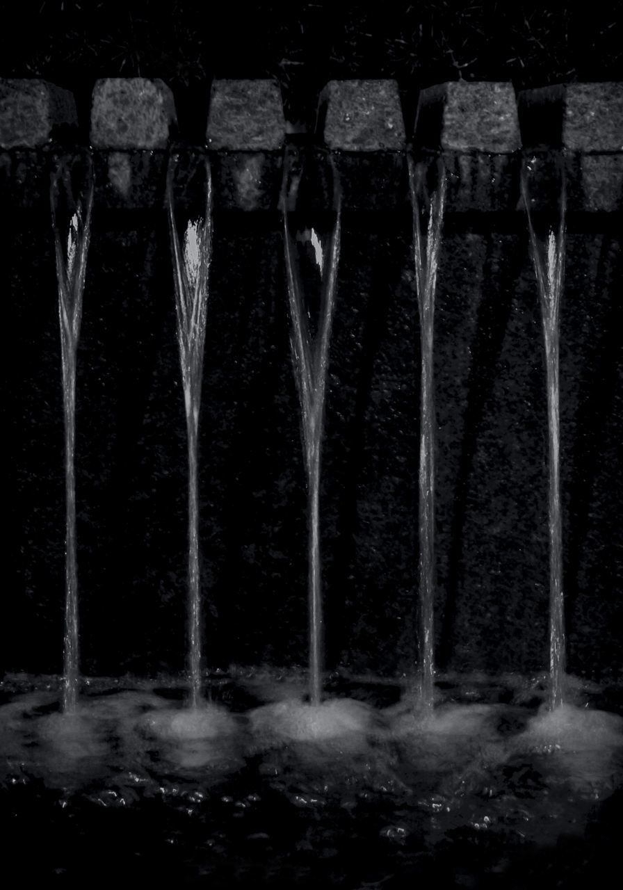 CLOSE-UP OF WATER FLOWING IN OLD BUILDING
