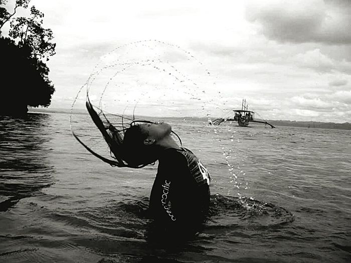 Waterreflections  Arch Water Reflections One Woman Only Water Sea Woman Portrait Fishing Net One Person Fishing Water Adults Only Sea Sky And Clouds One Woman Only Fisherman People Outdoors Blackandwhite Check This Out Nature Adult Boat Day Sky