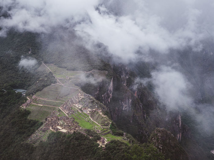 Machu Picchu Mountain Scenics - Nature Environment Landscape Beauty In Nature Cloud - Sky No People Smoke - Physical Structure Land Tranquil Scene Non-urban Scene Tranquility Fog Nature Day Sky Geology High Angle View Outdoors Mountain Peak