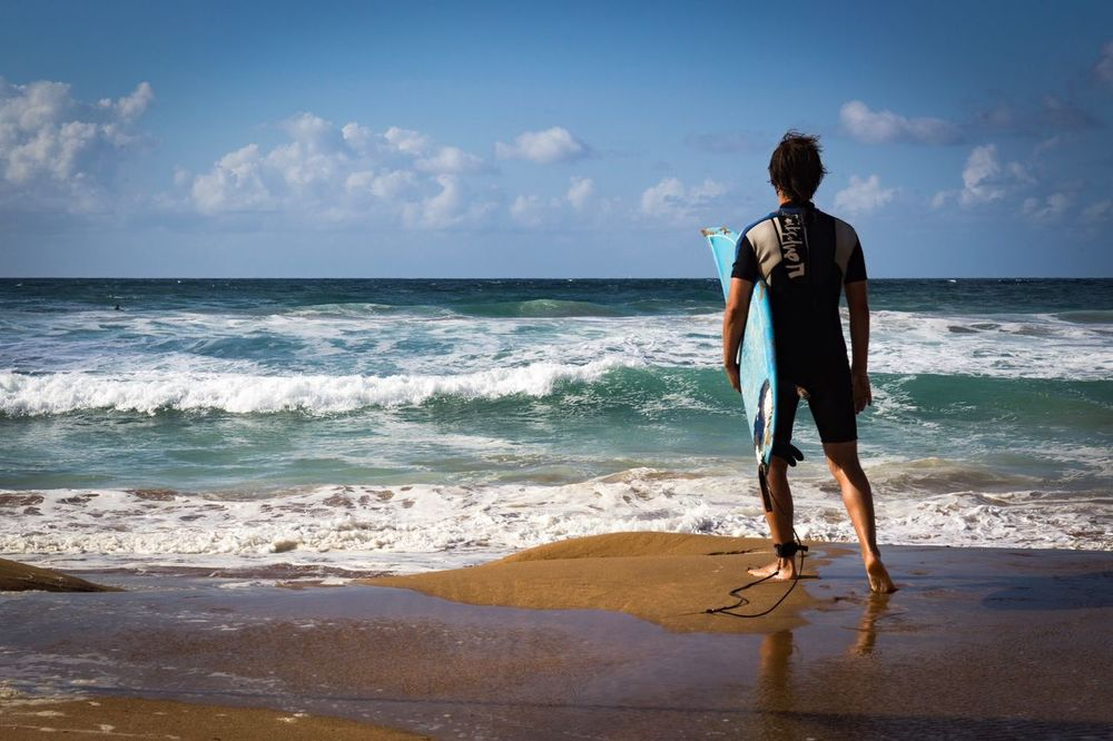 Sea Full Length Real People Beach Rear View Water Day Lifestyles One Person Standing Sky Leisure Activity Horizon Over Water Beauty In Nature Outdoors Young Adult Nature Cloud - Sky Wave Adventure Surf Surfing Life Is A Beach Enjoying Life Water Sports