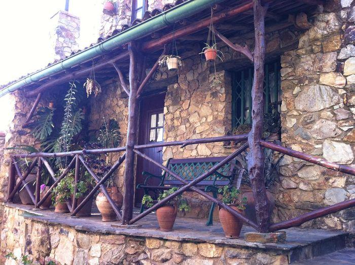 Typical Portuguese Stone village dwelling Plants Rustic Stone Cottagee Typical Portuguese Village Dwelling Architecture Flower Pots Wooden Veranda