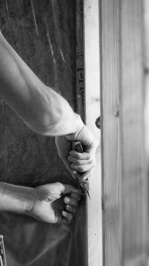 working hands construction 5 Hand Human Hand One Person Holding Door Human Body Part Entrance Real People Safety Men Wood - Material Day Crime Close-up Lifestyles Security Outdoors Body Part Protection Finger Human Limb Construction Site Blackandwhite