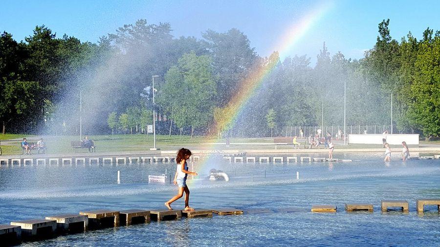 Full Length Of Girl Walking On Stepping Stones Against Sky