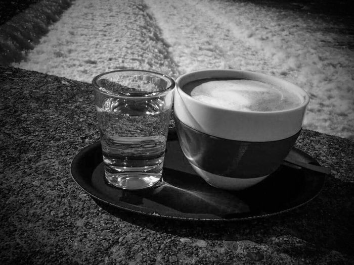 A good morning and a fresh hot beverage italian style with milk foam (Cappuccino) from the riverwalk of my hometown. Bnw_friday_eyeemchallenge Bnw_coffee