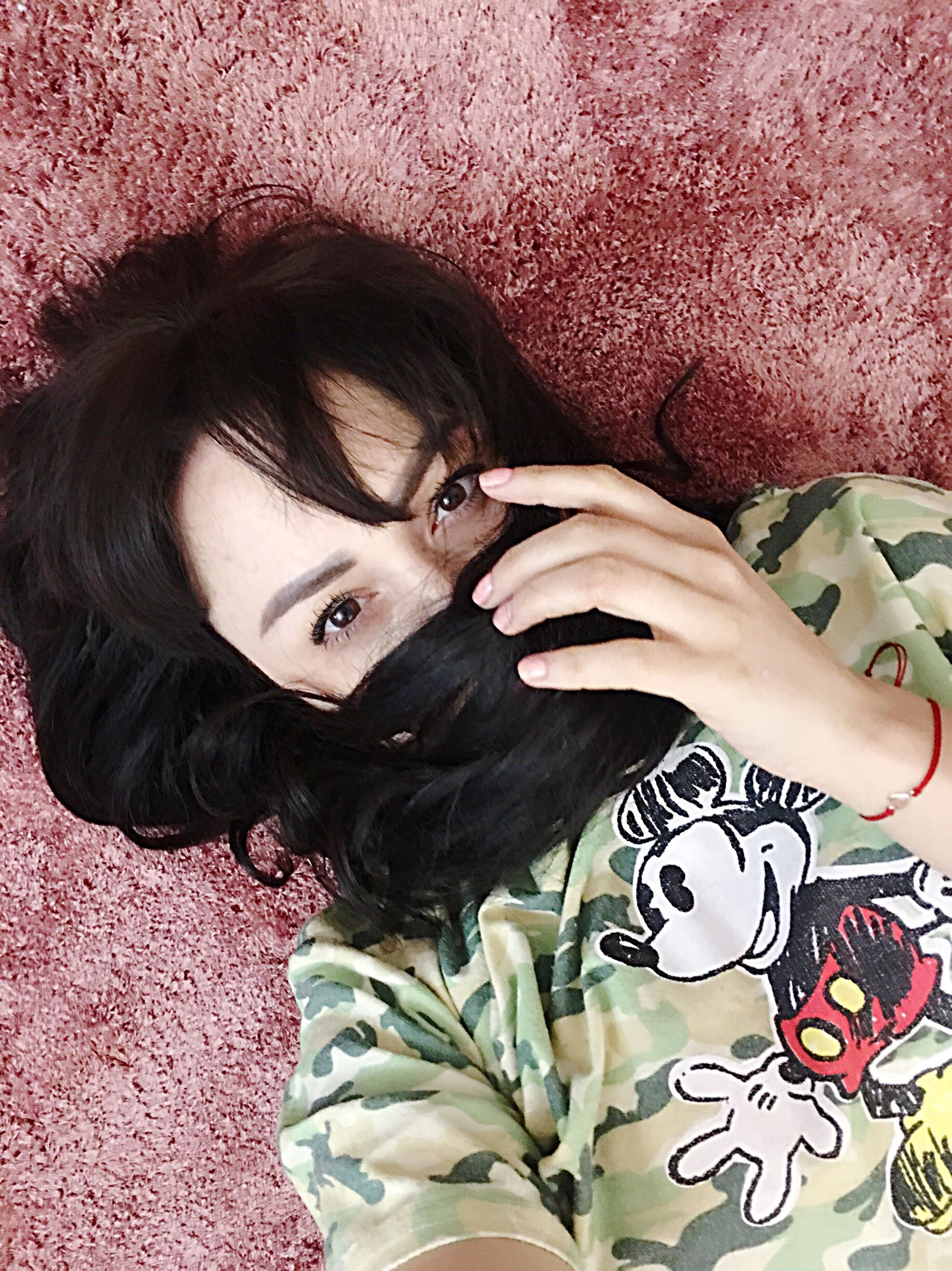 one person, real people, high angle view, black hair, leisure activity, indoors, portrait, looking at camera, lifestyles, day, close-up, people, young adult, adult, adults only