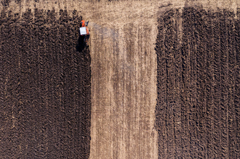Aerial view of tractor plowing farm
