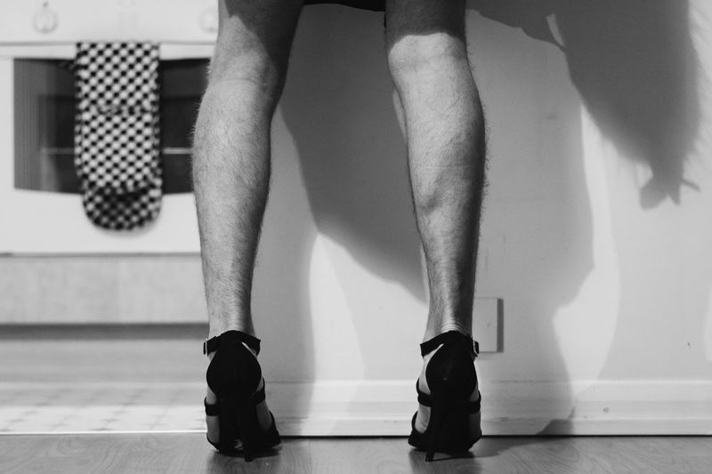 Close up of man wearing high heels