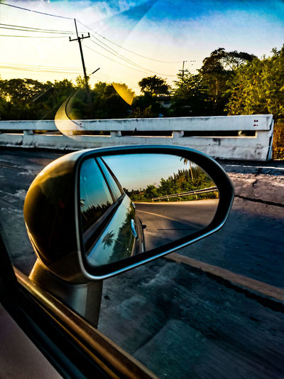 Reflection of road in side-view mirror