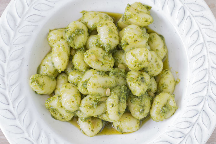 Close up of a plate of green gnocchi. Basil Dinner Fresh Produce Genova Gnocchi Lunch Break Above Carbohydrate Close-up Food Green Color Homemade Cake Italian Meals Olive Oil Organic Pasta Pine Nut Plate Potato Sauce Traditional Vegetable