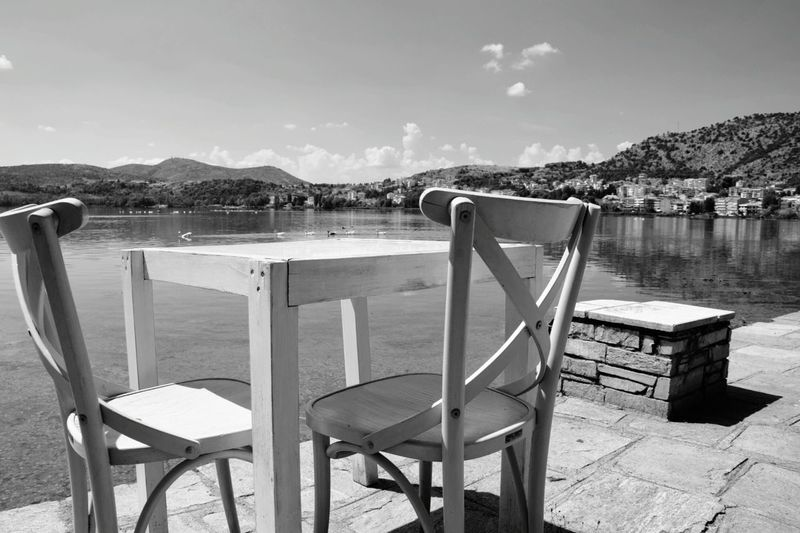 Blackandwhite Chairs Empty Mountain Absence Tranquil Scene Sky Tranquility Sea Mountain Range Cloud Scenics Outdoors Nature Day Riverbank No People Observation Point