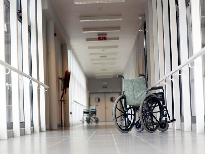 Wheelchair on empty hospital corridor