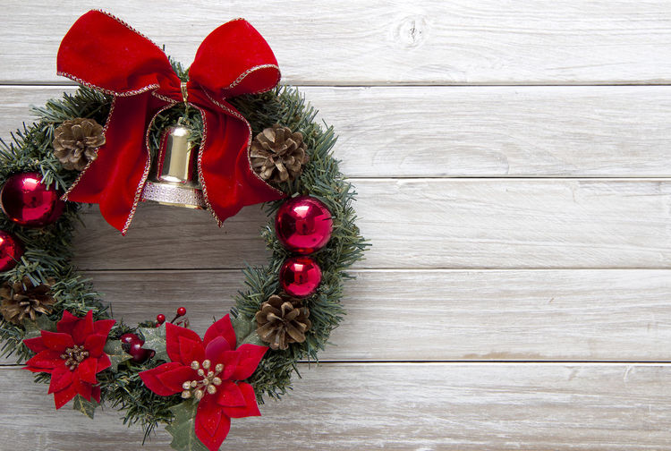 Close-Up Of Christmas Wreath On Wooden Table