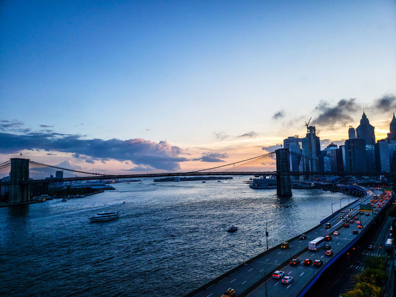 heading home from work Downtown District New York City Urban Skyline Exterior Manhattan Dusk Sunset Brooklyn Bridge / New York East River, NYC East River FDR Drive City Water Cityscape Sunset Bridge - Man Made Structure Sky Architecture Building Exterior Cloud - Sky Nautical Vessel