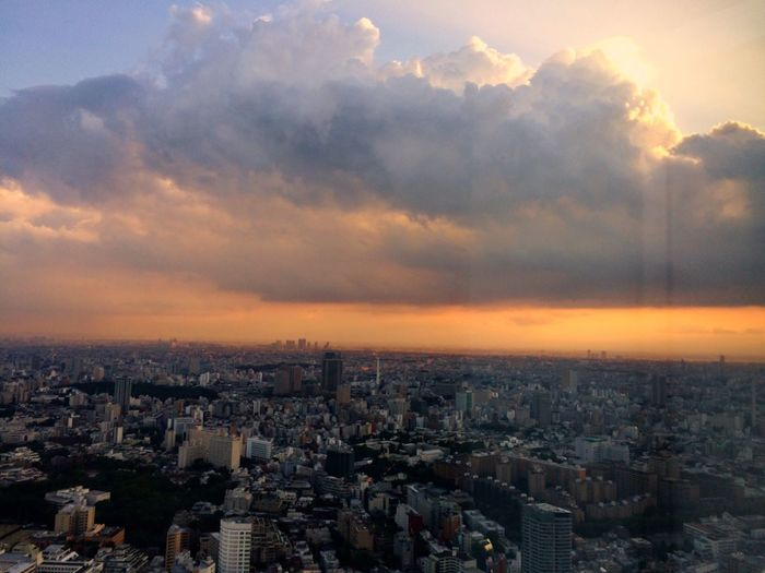High Angle Shot Of Cityscape Against Clouds