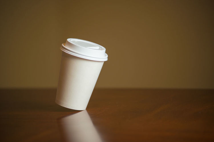 slanted coffee cup Falling Horizontal White Album Angle Brownie Close-up Coffee Cup Copyspace Indoors  Movement No People One Slanted Table