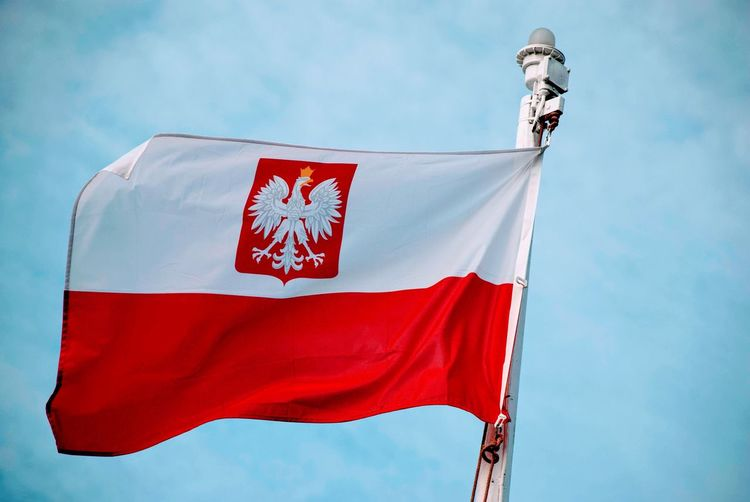 White Red Polish Poland Flag Patriotism Red Low Angle View Sky Day Nature Wind No People Waving Pride Pole National Icon Cloud - Sky