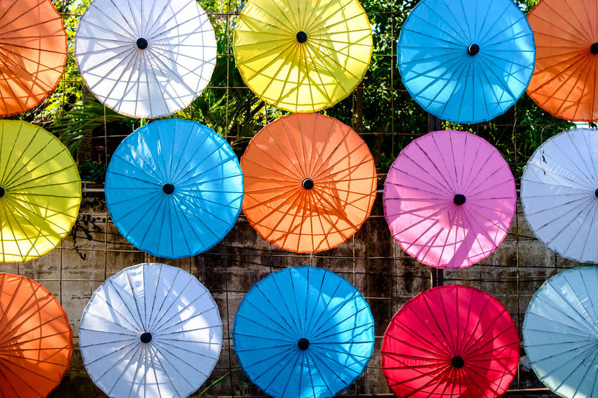 Rice paper umbrellas in Chiang Mai, Thailand. Chiang Mai Creativity Rice Paper Thailand Architecture Arrangement Backgrounds Colorful Day Decoration Hanging In A Row Multi Colored Nature No People Outdoors Pattern Protection Red Side By Side Umbrella