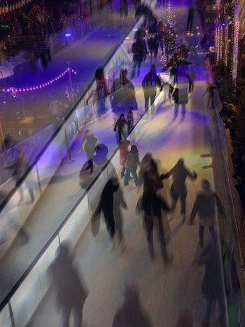 Iceskating Real People Leisure Activity Motion Lifestyles High Angle View Cold Temperature Ice-skating Illuminated Winter Focus On The Story Adventures In The City