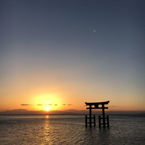 sunrise😆 Japan Sunrise Sunset Sea Scenics Beauty In Nature Horizon Over Water Nature Water Sky Clear Sky Sun Silhouette Tranquility Tranquil Scene Orange Color Idyllic No People Outdoors Built Structure Moon
