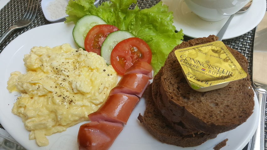 English breakfast, European toast and French butter in cafe in Vietnam. Toast🍞 Scrambled Eggs Sausage Tomato Salad Breakfast Dining Cafés Food Vietnam Close-up Sliced Bread Brown Bread Butter Processed Meat English Breakfast