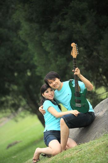 Full length of a boy playing guitar