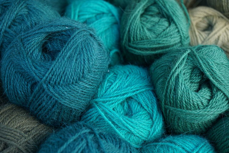 Knitting Wool Knitting Full Frame Textile Backgrounds Wool No People Close-up Multi Colored Stack Blue Ball Of Wool Day Thread Material Pattern Heap Outdoors Art And Craft Rope Abundance Textured  Turquoise Colored