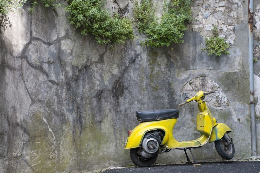 Day Green Color Italy Land Vehicle Mode Of Transport Moped Nature No People Outdoors Parked Parking Scooter Stationary Tranquility Vespa Yellow