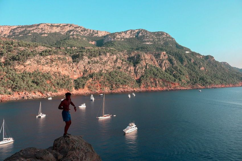 Mountain Real People Rock - Object Nature Leisure Activity Beauty In Nature Water Clear Sky Mallorca Scenics Rear View Day Lifestyles Full Length Outdoors Tranquility Standing Sea Men Young Adult