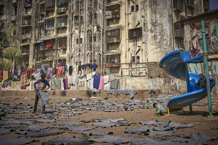 People walking by building in city