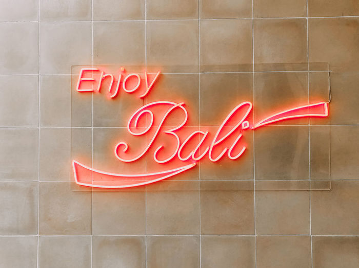 Enjoy Bali Text Red Message Positive Emotion Enjoying Life Neon Sign Bali, Indonesia Bali