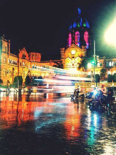 MUMBAI EyeEm Best Shots EyeEmNewHere Water Illuminated Carousel City Wet Reflection Sky Architecture Building Exterior Built Structure Light Trail Tail Light Long Exposure Vehicle Light Headlight High Street