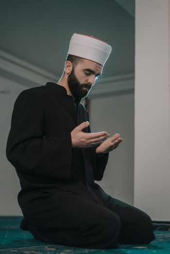 Low angle view of man in mosque